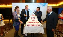 Environmental leaders from China and abroad cut EDF's 50th anniversary cake including, from left to right, Diane Regas, Executive Director of EDF, Erik Solheim, Under Secretary General of the United Nations and Executive Director of the United Nations Environment Programme, Zhang Li, Secretary General of the SEE Foundation, and Su Jilan, Academician with the Chinese Academy of Sciences and Honorary President of Second Institute of Oceanography in China's State Oceanic Administration.