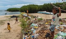 Children play by a dumping area in Bohol, Philippines