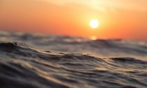 sunset over the ocean surface